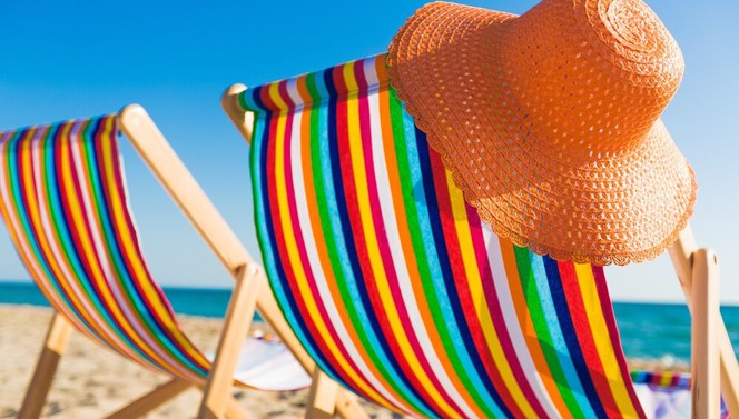 Beach chair with beach hat on the beach